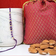 Purple Rakhi with Almonds  /></a></div><div class=