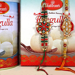 Rakhi pair with Rasgulla /></a></div><div class=
