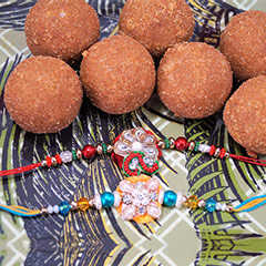 Rakhi Pair with Besan Laddu /></a></div><div class=