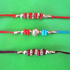 Triple Colorful Rakhi /></a></div><div class=