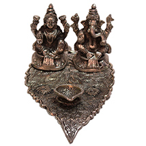Metallic statue of Laxmi & Ganesha