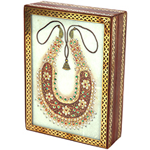 Marble jewellery box with open dazzling kundan necklace