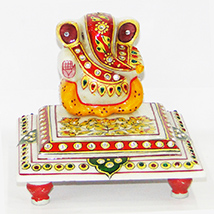 Marble ganesh idol sitting on chowki