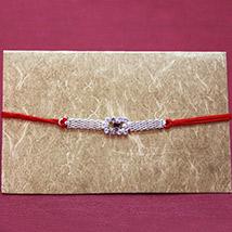 Elegant Silver Rakhi /></a></div><div class=