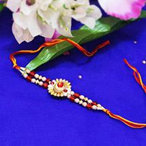 Elegant Pearl Rakhi /></a></div><div class=