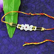 White Flower Rakhi /></a></div><div class=