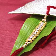 Elegant Sandalwood Rakhi /></a></div><div class=