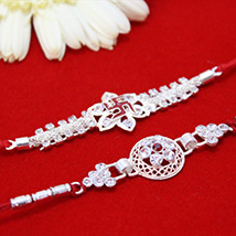 Stone Studded Silver Rakhis /></a></div><div class=
