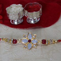 Silver, Golden & Red Rakhi /></a></div><div class=