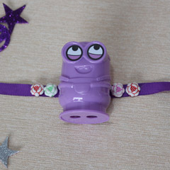 Purple Minion Rakhi with Sharpener