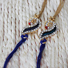 Two Sparkling Peacock Rakhis