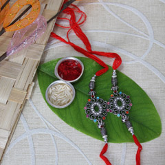 Black Metal Rakhi Set