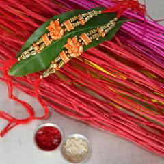 Saffron Ganesha Rakhi /></a></div><div class=