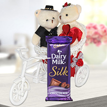 Cute Couple in Cycle with Chocolate