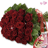 Red roses in vase & Lindt chocolates covenant with
