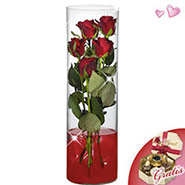 5 roses in glass vase with Lindt chocolates